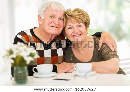 portrait of loving senior couple relaxing at home - stock photo
