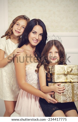 Portrait of luxury family with gold gift boxes - stock photo