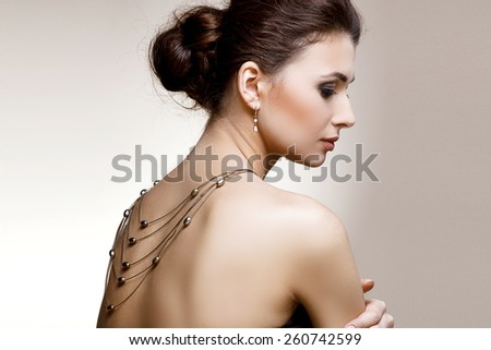 Portrait of luxury woman in exclusive jewelry on natural background