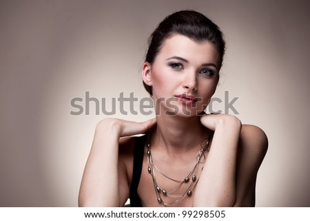 Portrait of luxury woman in exclusive jewelry on natural background - stock photo