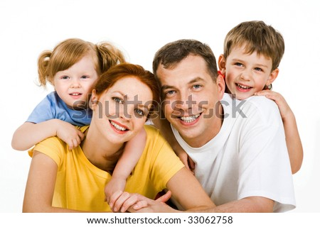Portrait of lying couple with children on their back - stock photo