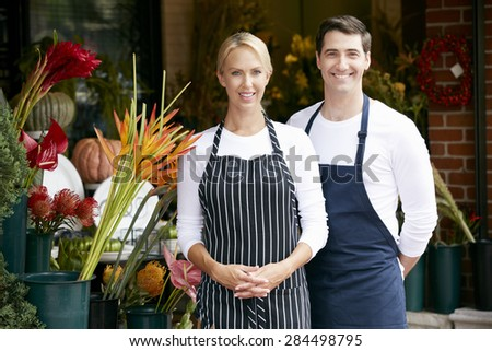 Portrait Of Male And Female Florist Outside Shop - stock photo
