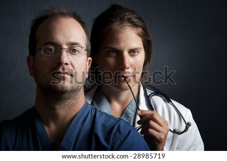 Portrait of male and female health care professionals - stock photo