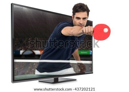 Portrait of male athlete playing table tennis against view of a stadium - stock photo
