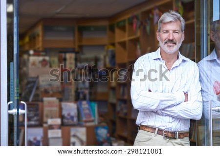 Portrait Of Male Bookshop Owner Outside Store - stock photo