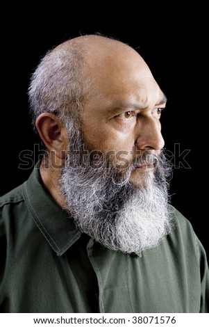 Portrait of male communist soldier with long beard over black background