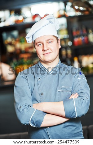 portrait of male cook chef at restaurant