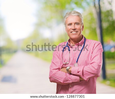 Portrait Of Male Doctor at a park - stock photo