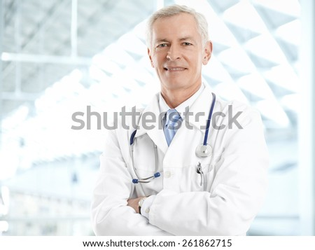 Portrait of male doctor standing at hospital.  - stock photo