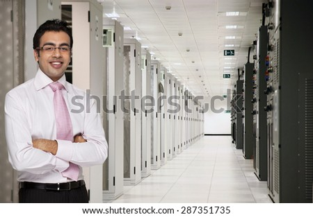 Portrait of male executive in server room - stock photo