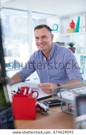 Portrait of male executive working at desk in the office