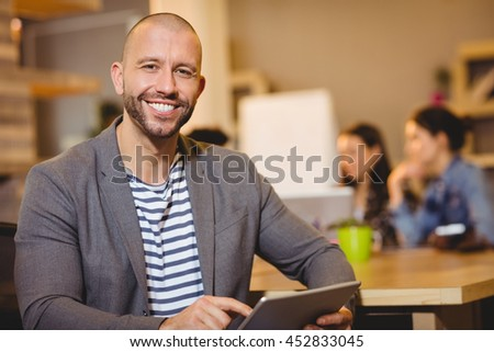 Portrait of male graphic designer using digital tablet in the office
