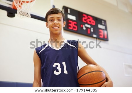 Portrait Of Male High School Basketball Player - stock photo