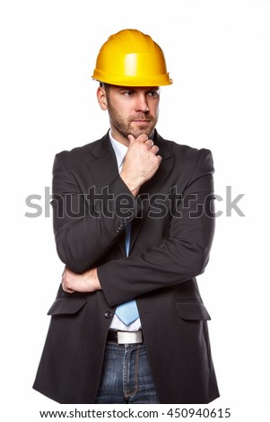 Portrait of male in a suit and yellow safety helmet isolated on a white background.