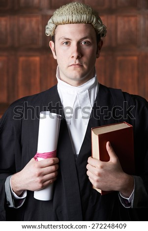 Portrait Of Male Lawyer In Court Holding Brief And Book - stock photo