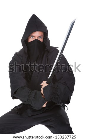Portrait of male ninja with weapon isolated over white background