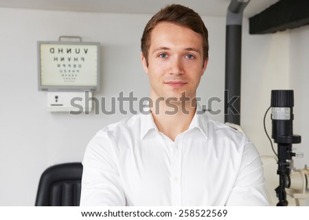 Portrait Of Male Optician In Optometrists - stock photo