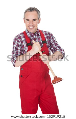 Portrait Of Male Plumber Holding Plunger���over white background - stock photo