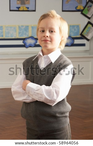 Portrait Of Male Primary School Pupil Standing In Classroom - stock photo