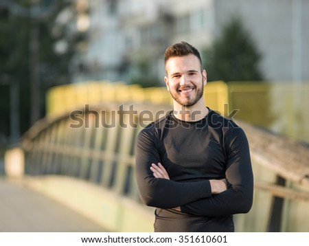 Portrait Of Male Runner On Urban Street - stock photo