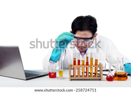 Portrait of male scientist makes an experiment and find a discovery, isolated on white - stock photo
