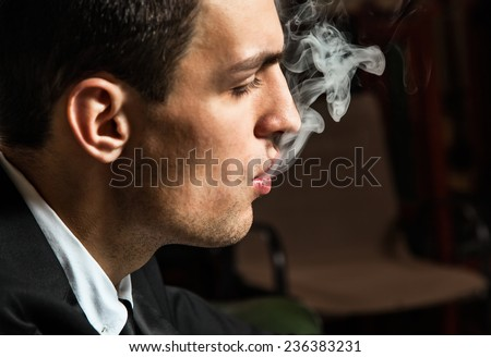 Portrait of male smokers - stock photo