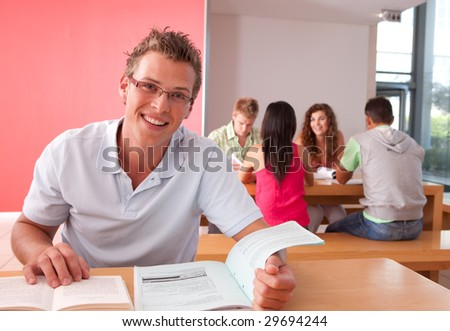 Portrait of male Student studying - stock photo