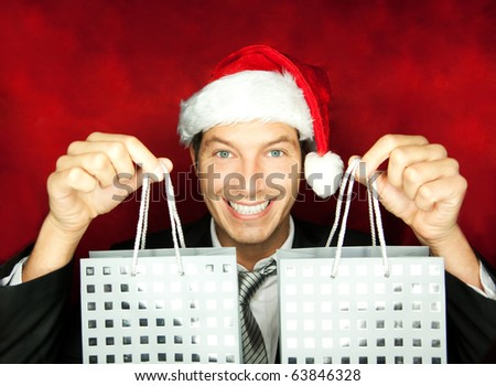 Portrait of male with present gift shopping bags - stock photo