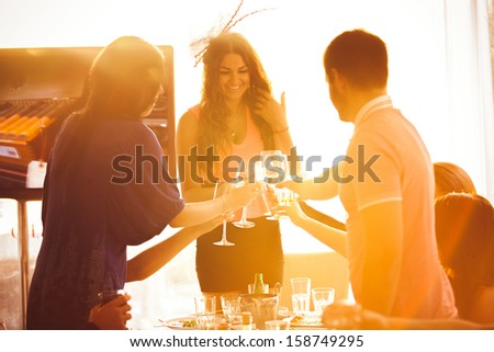 Portrait of man and woman greeting girl in restaurant - stock photo