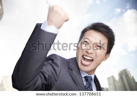 Portrait of Man Cheering - stock photo