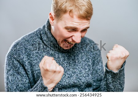 Portrait Of  Man Expressing His Excitement On Gray, Background - stock photo