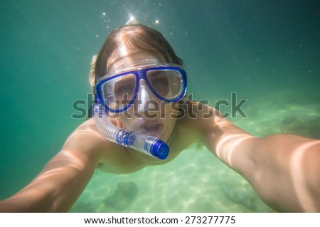 Portrait of man freedive snorkeling near coral tropical island - stock photo