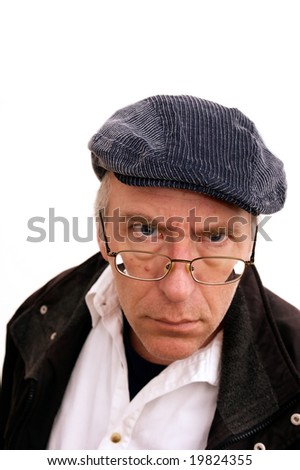 portrait of man glaring at viewer in hat and coat, on white - stock photo