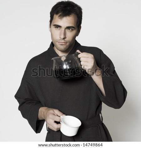 portrait of man in bathrobe drinking his coffee jar - stock photo