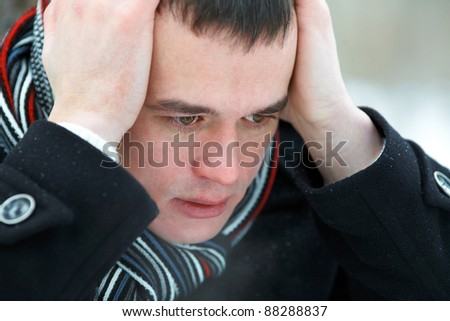 Portrait of man in despair outdoors - stock photo