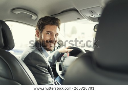 Portrait of man in his car. looking camera - stock photo