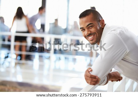 Portrait of man in office smiling - stock photo
