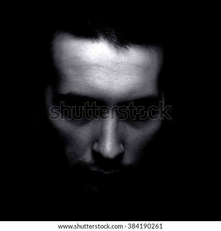 Portrait of man in shadow. Black and white silhouette. - stock photo