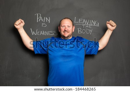 Portrait of Man, in Successful Weight Loss Program, Standing Next to Motivational Quote. - stock photo