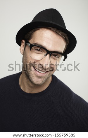 Portrait of man in trilby, smiling