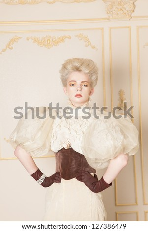 Portrait of man in woman's old-fashioned clothing, studio shot - stock photo