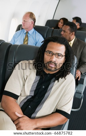 Portrait of man on airplane - stock photo