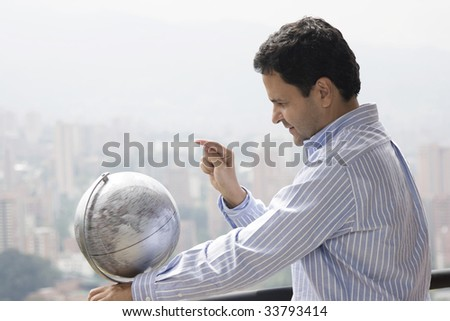 Portrait of man planning vacation with map