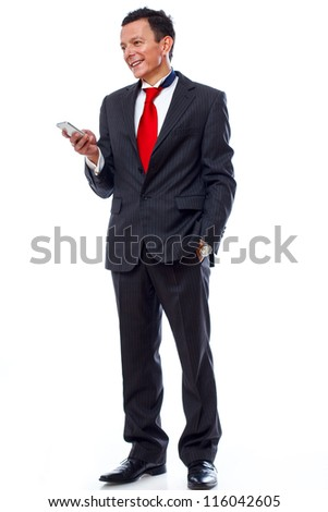 Portrait of man posing in studio in suit wwith phone