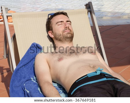 Portrait of man relaxing under the sunlight