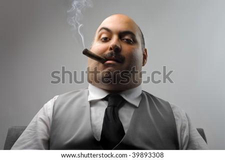 portrait of man smoking cigar - stock photo