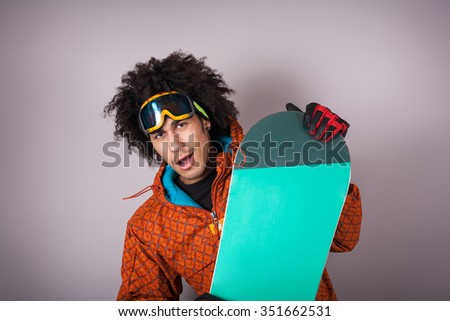 Portrait of man snowboarder in ski with a board - stock photo