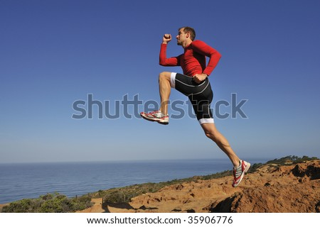 Portrait of man stepping off a cliff