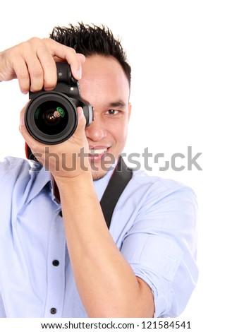 portrait of man using camera ready to take photo - stock photo