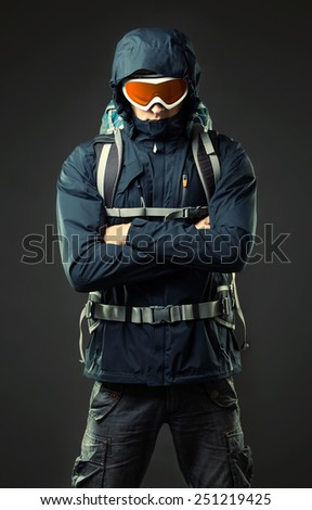 Portrait of man with backpack - stock photo